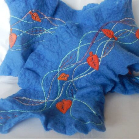 Sky Blue Merino Wool Scarf handmade by The Textile Alchemist. Hand felted finest merino wool scarf. Embellished with appliqued felt leaves & free couching.